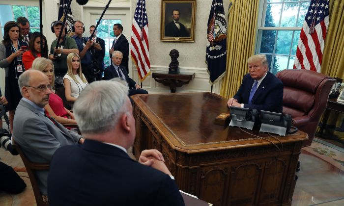 U.S. President Donald Trump listens as he gets an update from administration officials on the Fentanyl epidemic, in the Oval Office at the White House on June 25, 2019 in Washington, DC. (Mark Wilson/Getty Images)