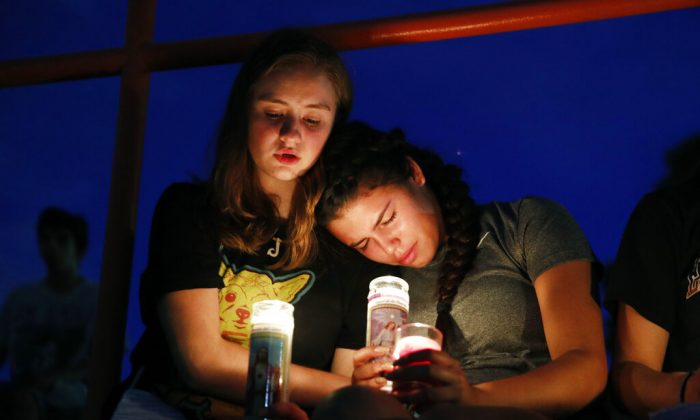 Melody Stout and Hannah Payan comfort each other during a vigil for victims of the shooting that occurred earlier in the day at a shopping center in El Paso, Texas, on Aug. 3, 2019. (John Locher/AP Photo)
