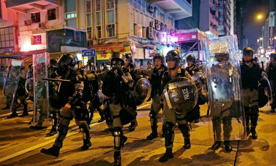Hong Kong Police Fire Tear Gas as Protests Again Roil the City