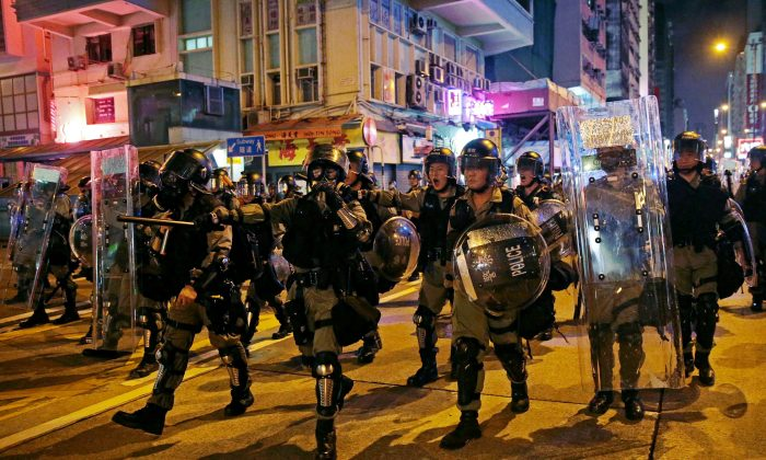 Police officers walk on a street after they dispersed anti-extradition bill protesters, in Hong Kong, on Aug. 3, 2019. (Eloisa Lopez/Reuters)