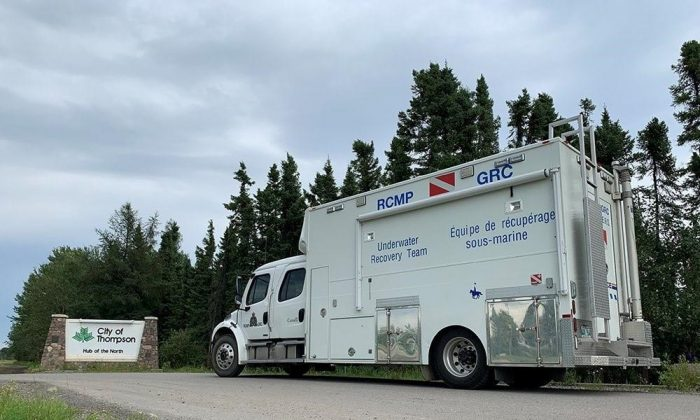 Manitoba RCMP's Underwater Recovery Team (URT) is seen in this police image published to social media on August 3, 2019. Divers will begin to search a section of the Nelson River which is northeast of Gillam, MB, August 4. (HO-Twitter, RCMP @rcmpmb/The Canadian Press)