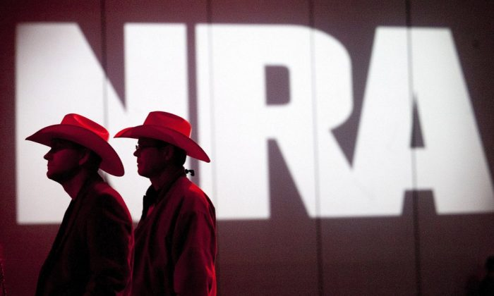 National Rifle Association members listen to speakers during the NRA's 142 annual Meetings and Exhibits at the George R. Brown Convention Center in Houston on May 4, 2013. (Johnny Hanson/Houston Chronicle via AP, File)