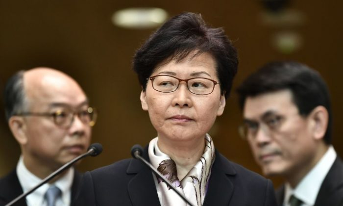 Hong Kong leader Carrie Lam (C) attends a press conference in Hong Kong on Aug. 5, 2019. (Anthony Wallace/AFP/Getty Images)