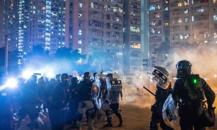 Riot police stand off against protestors at Wong Tai Sin district in Hong Kong on Aug. 5, 2019. (Billy H.C. Kwok/Getty Images)