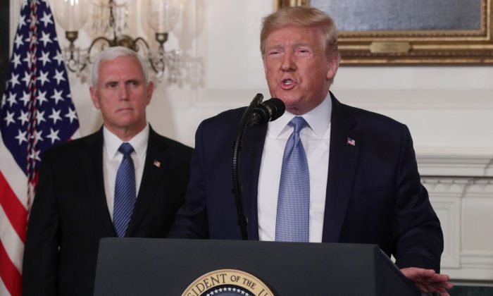 President Donald Trump makes remarks in the Diplomatic Reception Room of the White House as U.S. Vice President Mike Pence looks on Aug. 5, 2019. (Alex Wong/Getty Images)