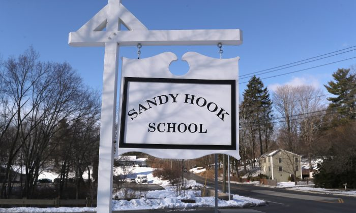 A sign stands near the site of the December 2012 Sandy Hook school shooting in Sandy Hook Connecticut, on March 14, 2018. (John Moore/Getty Images)