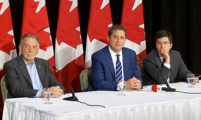 (L-R) Conservative MP Peter Kent, Conservative Leader Andrew Scheer, and Conservative MP Garnett Genuis during a roundtable Q&A with ethnic media reporters in Etobicoke, Ont., on Aug. 2, 2019. (Arek Rusek/NTD Television)