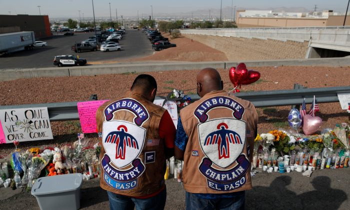 People pray a makeshift memorial for victims of a mass shooting at a shopping complex, in El Paso, Texas, on Aug. 5, 2019. (John Locher/AP Photo)