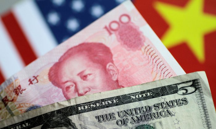 U.S. Dollar and China Yuan notes on a picture illustration on June 2, 2017. (Reuters/Thomas White/Illustration/File Photo)