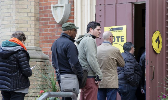Voters line up at a polling station in Toronto Centre during the last federal election on Oct. 19, 2015. (The Canadian Press/Colin Perkel)