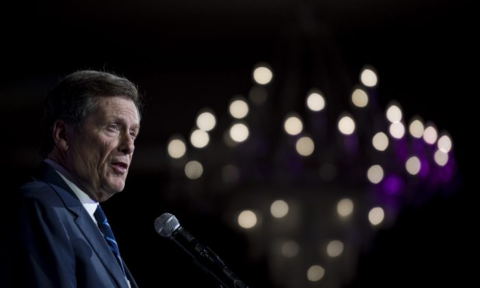 Toronto Mayor John Tory delivers remarks to attendees of the Canadian Muslim Vote's Eid Dinner, in Toronto, on June 21, 2019. (Christopher Katsarov/The Canadian Press)