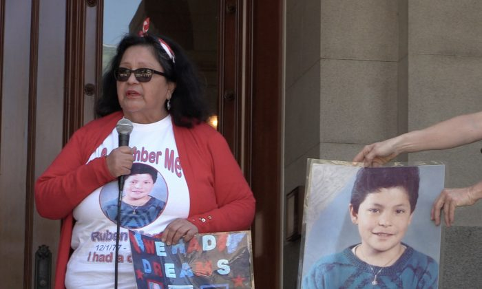 Angie Morfin with a picture of her son speaking in front of California State Capitol building on on June 21, 2019. (Nathan Su/Epoch Times)
