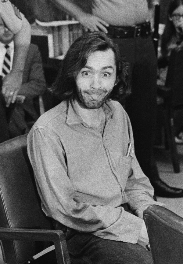 Charles Manson sticks his tongue out