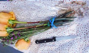 Airport Security Finds Passenger Carrying a Knife in Bunch of Flowers