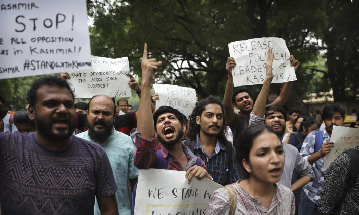 Left party supporters and students shout slogans during a protest against Indian government revoking Kashmir's special constitutional status in New Delhi, India, Aug. 5, 2019. (Manish Swarup/AP)
