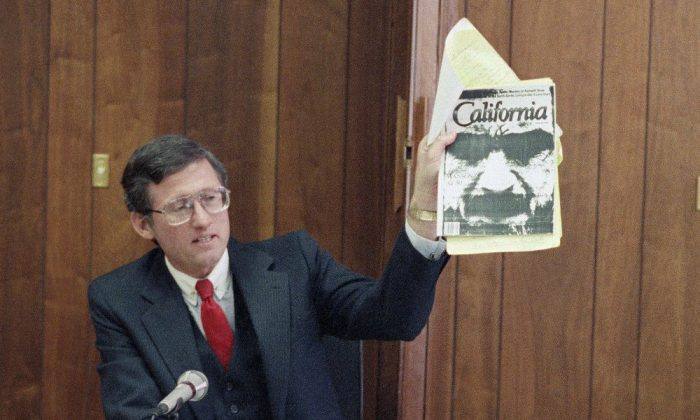 Los Angeles Deputy District Attorney Stephen Kay holds up a magazine profiling convicted murderer Charles Manson while delivering his closing statement at Manson's parole hearing at San Quentin Prison, Calif., on Feb. 9, 1989. (Eric Risberg/AP Photo)