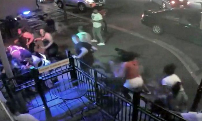 People try to escape a mass shooting outside of Ned Peppers in Dayton, Ohio, on Aug. 4, 2019. (Dayton City Handout via Reuters)