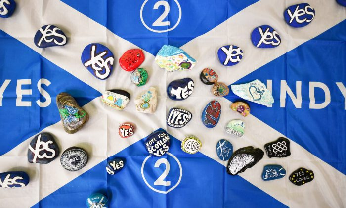 A Saltire flag has painted stones placed on it as delegates attend day one of the SNP Spring Conference at the Edinburgh International Conference Centre on April 27, 2019 in Edinburgh, Scotland. (Jeff J Mitchell/Getty Images)