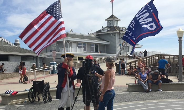 Trump rally participants are interviewed in Newport Beach, Calif., on Aug. 3, 2019. (Ian Henderson/The Epoch Times)