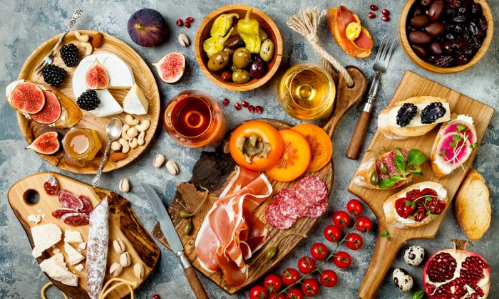 Prepare a couple kinds of bruschette and crostini, add a cheese and charcuterie board, and round it out with a good bottle of wine.(Shutterstock)