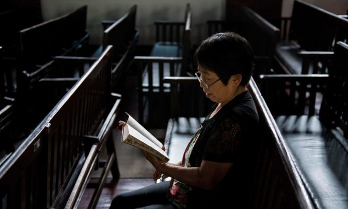 A woman reads the Bible at the Christian Glory church in Wuhan,a city in China's Hebei Province, on Sept. 23, 2018. (Nicolas Asfouri/AFP/Getty Images)