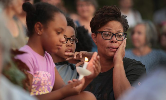 Mourners attend a memorial service to remember the victims of Sunday morning's mass shooting in the Oregon District of nearby Dayton  in Springfield, Ohio, on August 05, 2019. (Scott Olson/Getty Images)