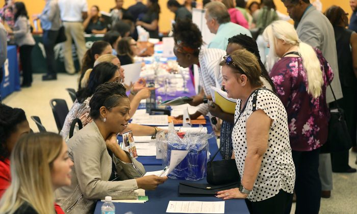 People attend a job fair in Miami, Fla., on April 5, 2019. (Joe Raedle/Getty Images)