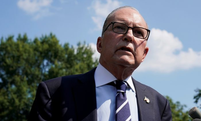 White House chief economic adviser Larry Kudlow speaks with reporters on the driveway outside the West Wing of the White House on July 26, 2019. (Yuri Gripas/Reuters)