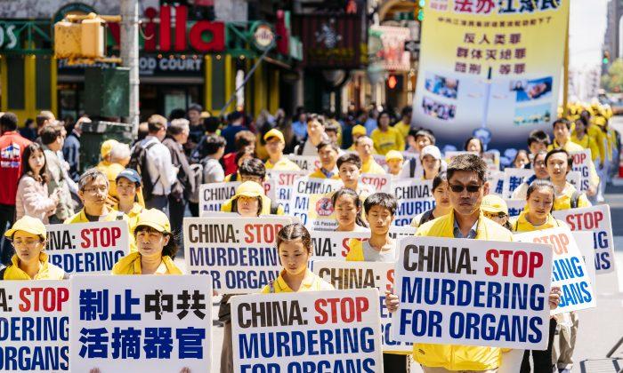 Falun Dafa Day parade in Manhattan, New York City, on May 16, 2019. (Edward Dye/The Epoch Times)