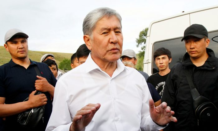 Kyrgyz former President Almazbek Atambayev, who was stripped of legal immunity after a parliamentary vote, and his supporters attend a meeting with journalists in the village of Koy-Tash near Bishkek, Kyrgyzstan on June 27, 2019. (Vladimir Pirogov/File Photo via Reuters)