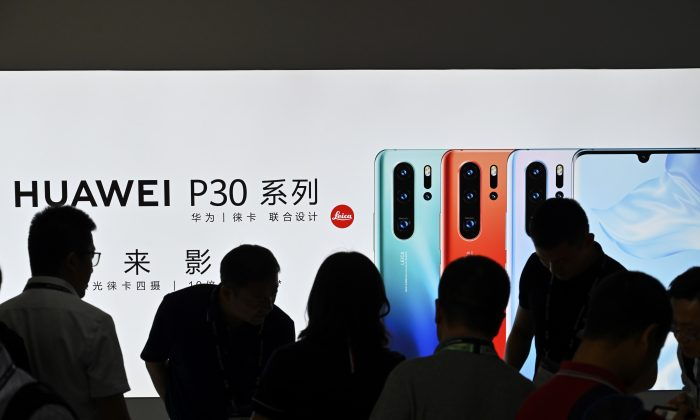 People visit a Huawei stand during the Mobile World Congress introducing next-generation technology at the Shanghai New International Expo Centre(SNIEC) in Shanghai on June 26, 2019. (Hector Retamal/AFP/Getty Images)