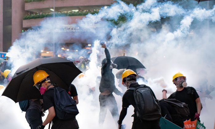 Protesters stand off against riot police at Wong Tai Sin district on August 05, 2019 in Hong Kong, China. (Billy H.C. Kwok/Getty Images)