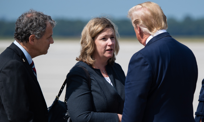 President Donald Trump greets Dayton Mayor Nan Whaley (C) as he arrives at Wright-Patterson Air Force Base in Ohio on Aug. 7, 2019. (Saul Loeb/AFP/Getty Images)