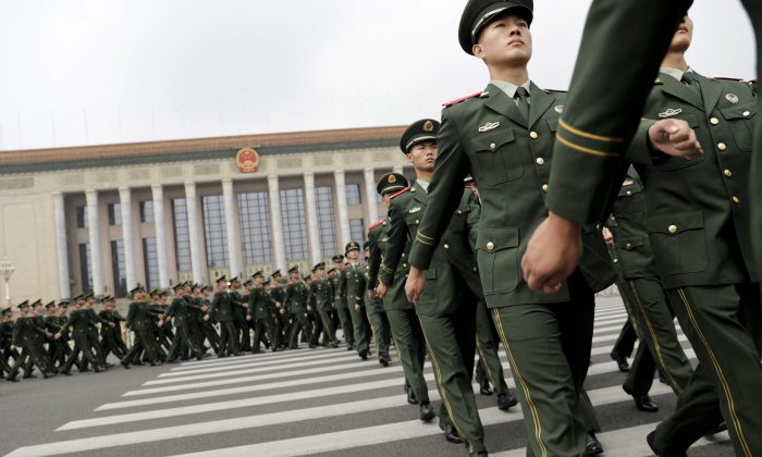 Chinese paramilitary policemen march outside the Great Hall of the People after attending a ceremony to commemorate the 90th anniversary of the founding of the People's Liberation Army, in Beijing on August 1, 2017.