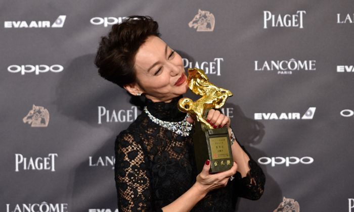 "Hong Kong actress Kara Hui Ying-hung, also known as Kara Wai, poses after winning the Best Leading Actress Award for her film ""The Bold, the Corrupt, and the Beautiful"" at Taiwan's 54th Golden Horse film awards, dubbed the Chinese ""Oscars"", in Taipei on November 25, 2017. (SAM YEH/AFP/Getty Images)"