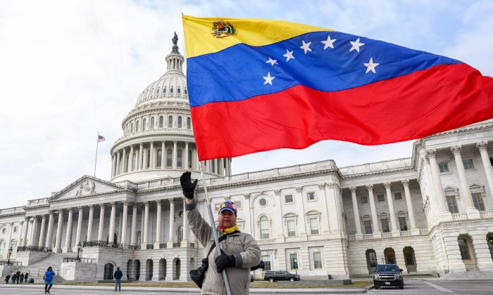 A man waves the Venezuelan flag in front of the Capitol building in Washington on March 7, 2019. (Charlotte Cuthbertson/The Epoch Times)