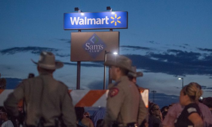 Texas State Troopers keep watch at the makeshift memorial for victims of the shooting that left a total of 22 people dead at the Cielo Vista Mall WalMart in El Paso, Texas, on Aug. 6, 2019. (Mark Ralston/AFP/Getty Images)