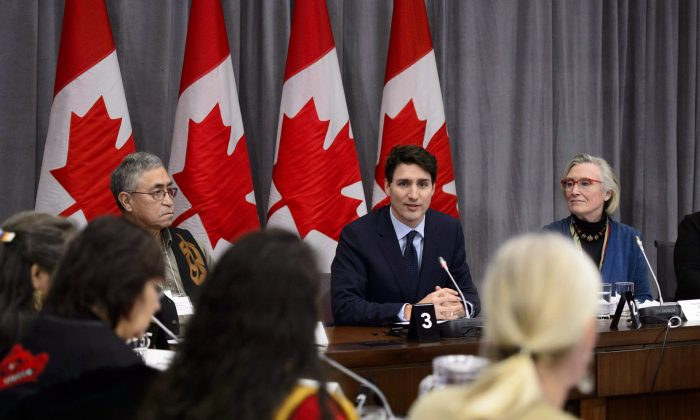 Prime Minister Justin Trudeau takes part in the Canada-Modern Treaty and Self-Governing First Nations Forum, with Legislative Chief Peter Hanson (L) and Minister of Crown-Indigenous Relations Carolyn Bennett, in Ottawa on Jan. 8, 2019. (The Canadian Press/Sean Kilpatrick)