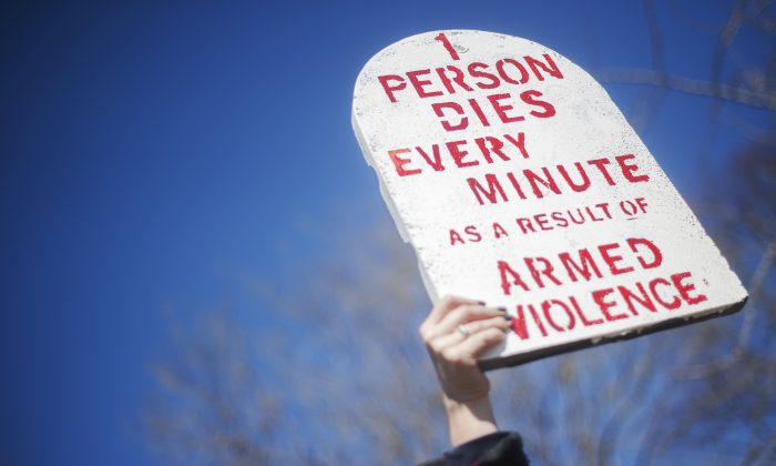 A demonstrator from Amnesty International holds up a placard outside the White House on March 22, 2013 in in Washington., (JIM WATSON/AFP/Getty Images)