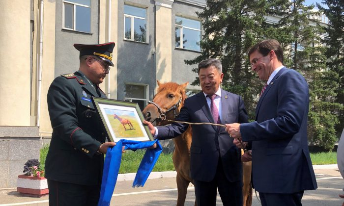 U.S. Secretary of Defense Mark Esper is gifted a horse in Ulan Bator, Mongolia on Aug. 8, 2019. (Idrees Ali/Reuters)