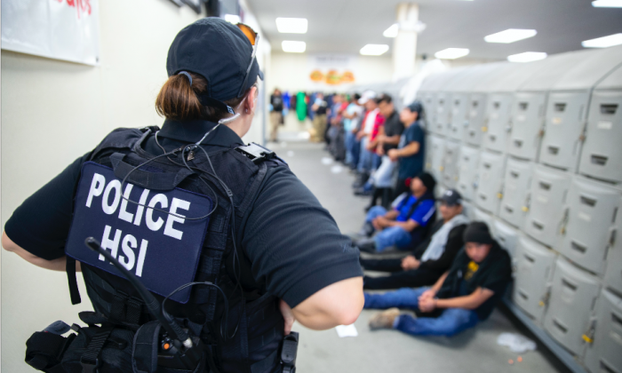 ICE arrests illegal immigratnts during a worksite enforcement operation in Canton, Miss., on Aug. 7, 2019. (ICE)
