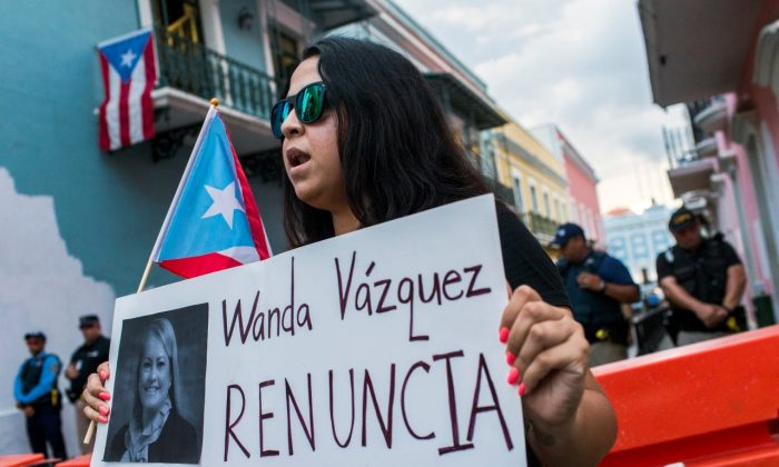Protesters gather outside the government mansion La Fortaleza calling for the removal of the island's newly sworn-in governor in San Juan, Puerto Rico, on Aug. 7, 2019. (Dennis M. Rivera Pichardo/AP Photo)