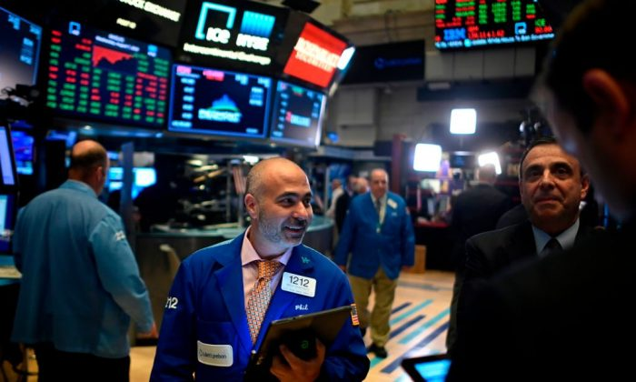 Traders work after the closing bell at the New York Stock Exchange in New York City, on August 7, 2019.  (JOHANNES EISELE/AFP/Getty Images)
