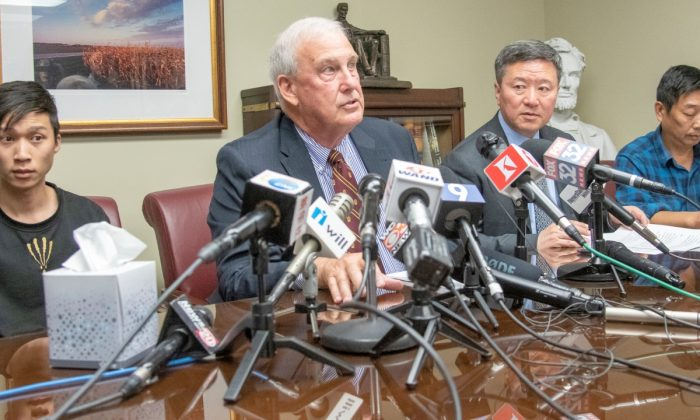 (L-R) Yingying Zhang's brother Zhengyang Zhang, Attorney Steve Beckett, Attorney Zhidong Wang, and Yingying's father Ronggao Zhang appear at a press conference at Beckett's law office in Urbana, Ill., on Aug. 7, 2019. (Robin Scholz/The News-Gazette via AP )