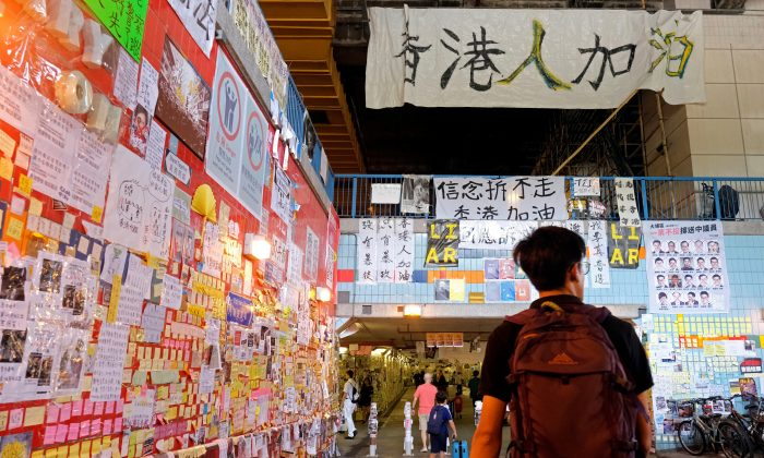 "Memos and posters over anti-extradition bill are seen on ""Lennon Walls"" at Tai Po in Hong Kong, China on Aug. 9, 2019. (Tyrone Siu/Reuters)"