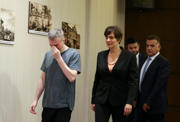 Canadian citizen, Kristian Lee Baxter, who was being held in Syria reacts as he walks next to Canadian Ambassador to Lebanon, Emmanuelle Lamoureux and Major General Abbas Ibrahim, Lebanon's internal security chief, after being released, in Beirut, Lebanon August 9, 2019. (Mohamed Azakir/Reuters)
