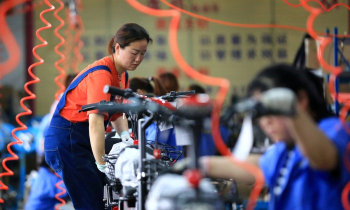 Workers manufacturing electric bicycles at a factory in Huaian, Jiangsu Province, China on May 26, 2019. (Reuters)
