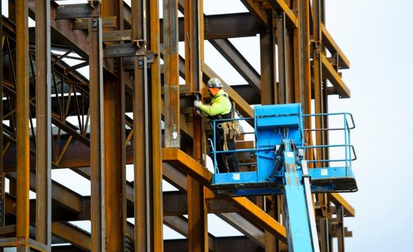 Canada lost 24,200 jobs last month and its unemployment rate moved up to 5.7 percent to give the economy its weakest three-month stretch of job creation since early 2018. A steel worker builds a structure in Ottawa on March 5, 2018. (Sean Kilpatrick/The Canadian Press)