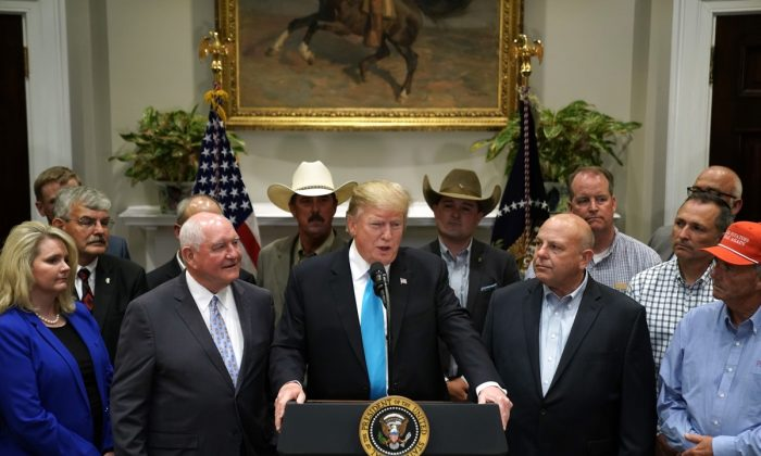 President Donald Trump delivers remarks in support of farmers and ranchers with Agriculture Secretary Sonny Perdue (3rd L) in the Roosevelt Room at the White House in Washington on May 23, 2019. (Chip Somodevilla/Getty Images)