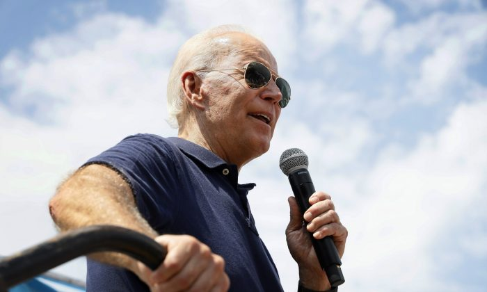 Democratic presidential candidate former Vice President Joe Biden speaks at the Des Moines Register Soapbox during a visit to the Iowa State Fair in Des Moines, Iowa on Aug. 8, 2019. (AP Photo/Charlie Neibergall)